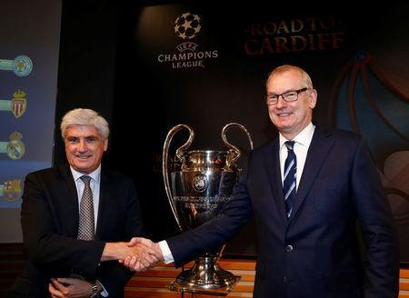 Club Atletico de Madrid Manager Clemente Villaverde (L) shakes hands with Andrew Neville, Football Operations Director of Leicester City FC, after the draw of the UEFA Champions League quarterfinals in Nyon, Switzerland March 17, 2017. REUTERS/Denis Balibouse