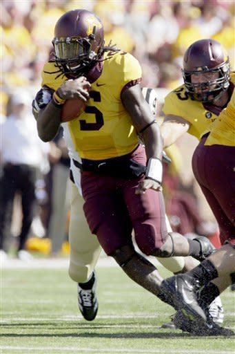 Minnesota quarterback MarQueis Gray (5) runs against Western Michigan during the first half of an NCAA college football game, Saturday, Sept. 15, 2012, in Minneapolis. (AP Photo/Paul Battaglia)