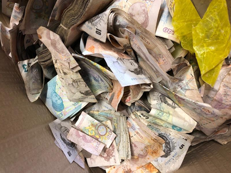 Some of the £20,000 in old notes and coins found inside the safe: Sackers