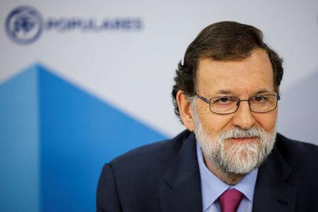 Spain's Prime Minister Mariano Rajoy attends a meeting at People's Party (PP) headquarters in Madrid