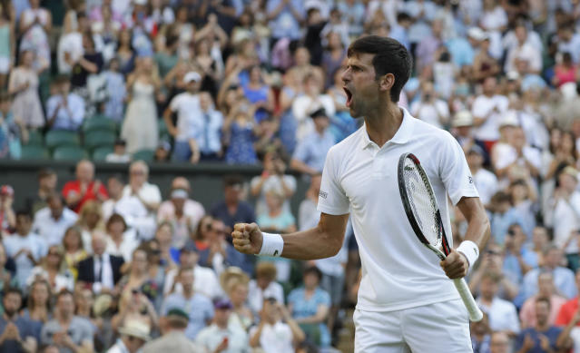 Serbia's Novak Djokovic celebrates winning a break point during his men's singles match against Kyle Edmund of Great Britain, on the sixth day of the Wimbledon Tennis Championships in London, Saturday July 7, 2018. (AP Photo/Kirsty Wigglesworth)