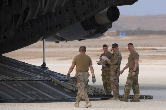 In this Oct. 24, 2019, photo, released by the U.S. Army Reserve, U.S. Airmen check their manifest for military equipment to be loaded onto a cargo plane at Kobani Landing Zone (KLZ), Syria. Pivoting from the dramatic killing of the Islamic State group's leader, the Pentagon is increasing U.S. efforts to protect Syria's oil fields from the extremist group as well as from Syria itself and the country's Russian allies. It's a new high-stakes mission even as American troops are withdrawn from other parts of the country.(U.S. Army Reserve photo by Staff Sgt. Joshua Hammock via AP)
