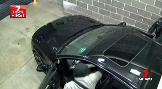 One of the crooks allegedly ran to the passenger's door and started hacking. Source: 7 News