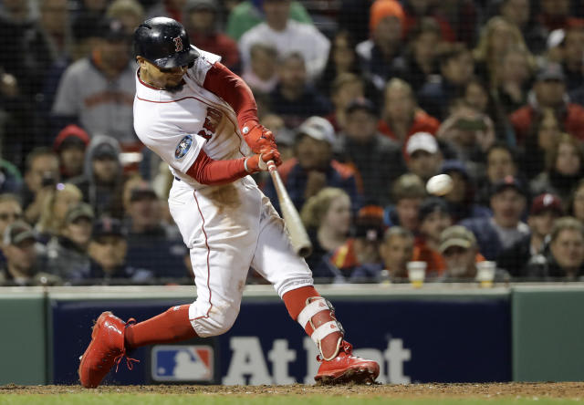 Boston Red Sox's Mookie Betts hits a RBI-double against the Houston Astros during the eighth inning in Game 2 of a baseball American League Championship Series on Sunday, Oct. 14, 2018, in Boston. (AP Photo/David J. Phillip)