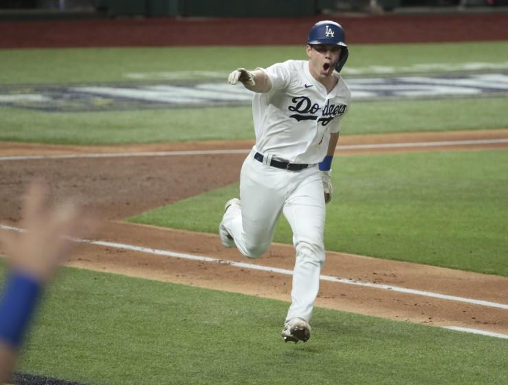 Dodgers catcher Will Smith reacts after hitting a two-run single during the third inning in Game 7 of the NLCS.