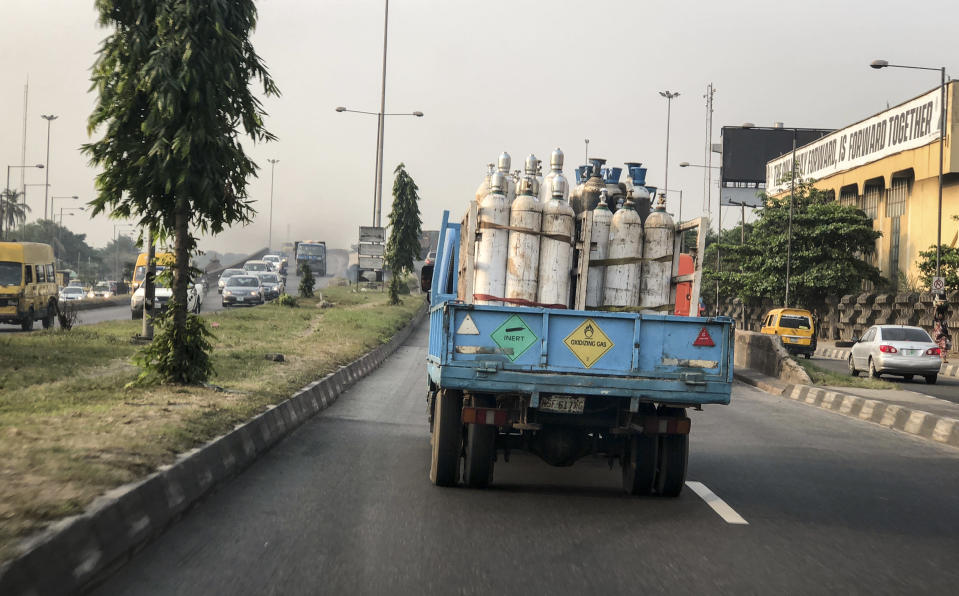 A truck transports bottles of oxygen along a street in Lagos, Nigeria Saturday, Feb. 6, 2021. A crisis over the supply of medical oxygen for coronavirus patients has struck in Africa and Latin America, where warnings went unheeded at the start of the pandemic and doctors say the shortage has led to unnecessary deaths. Doctors in Nigeria anxiously monitor traffic as oxygen deliveries move through gridlocked streets of Lagos. (AP Photo/Lekan Oyekanmi)