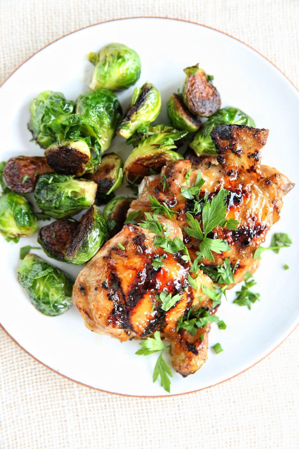 """<p>A little char goes a long way with these sticky-and-sweet chicken thighs and seared brussels sprouts.</p><p>Get the recipe from <a href=""""https://www.delish.com/cooking/recipe-ideas/recipes/a48418/apricot-glazed-chicken-with-brussels-sprouts-recipe/"""" rel=""""nofollow noopener"""" target=""""_blank"""" data-ylk=""""slk:Delish"""" class=""""link rapid-noclick-resp"""">Delish</a>.</p>"""