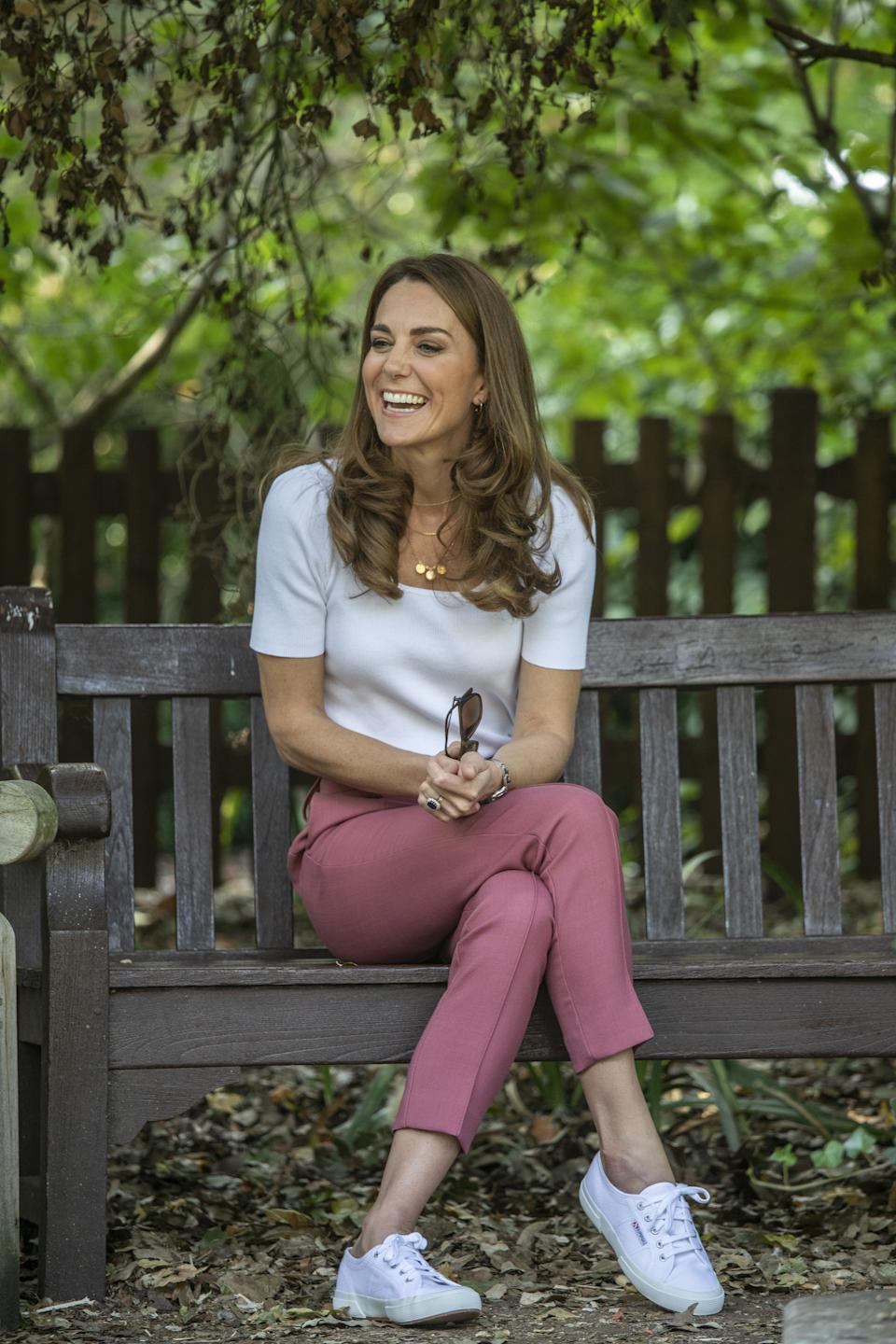 Though Kate Middleton's M&S trousers have sold out, fans can emulate the look and  snap up her Superga trainers.  (PA Images)