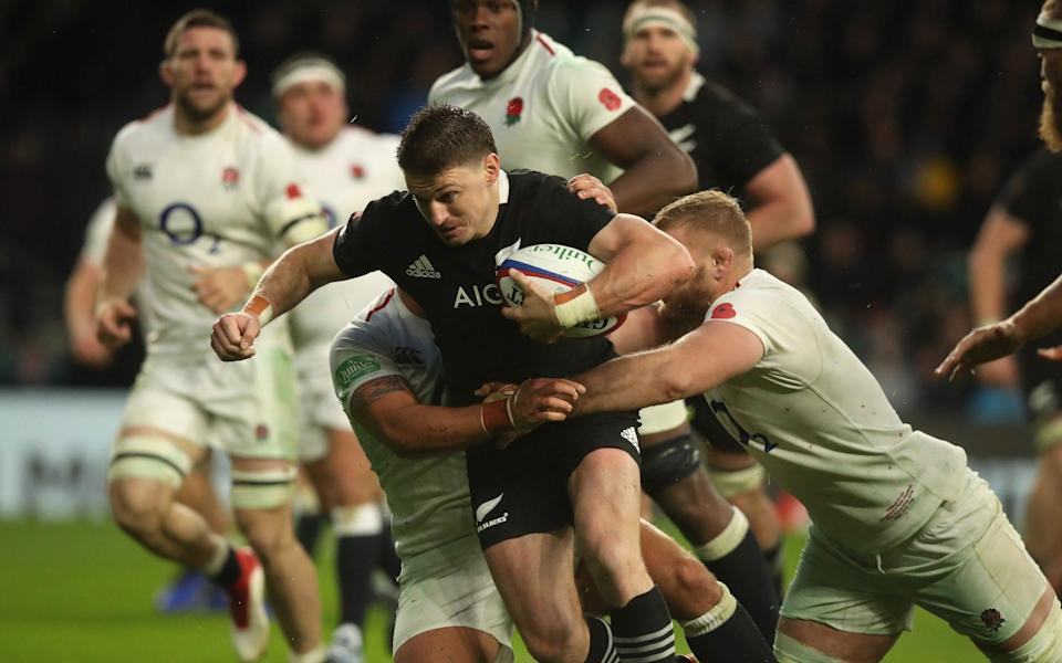 Beauden Barrett of New Zealand is tackled during the Quilter International match between England and New Zealand - Getty Images