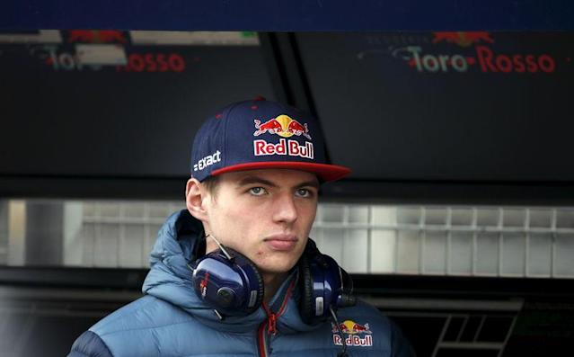 Toro Rosso Formula One driver Max Verstappen of The Netherlands looks on in pit lane in Montmelo