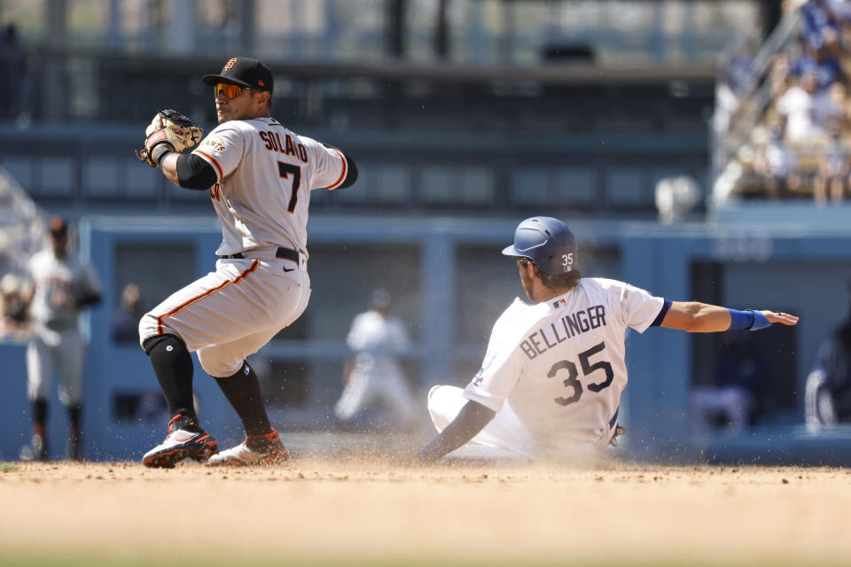 Cody Bellinger of the Los Angeles Dodgers slides into second base as Donovan Solano of the San Francisco Giants attempts to throw to first for a double play. (Photo by Michael Owens/Getty Images)