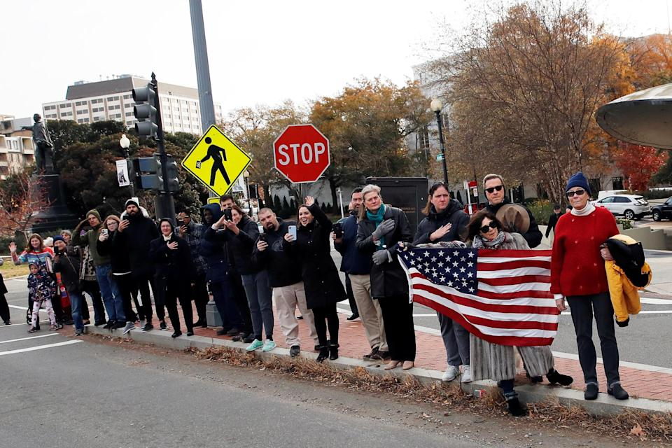 People line the streets to pay their respects as the hearse with the casket of former President George H.W. Bush passes by on the way to Andrews Air Force Base after a State Funeral at the National Cathedral, Wednesday, Dec. 5, 2018, in Washington. (Photo: Alex Brandon/Pool via Reuters)