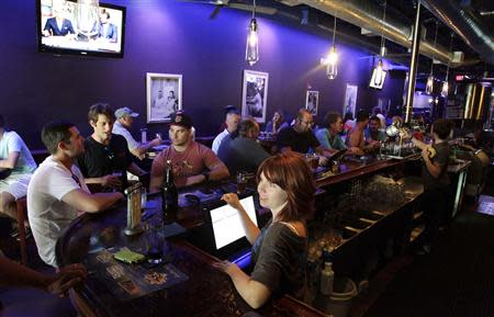 Kristin Masson serves beers at Tequesta Brewing Co. in Tequesta