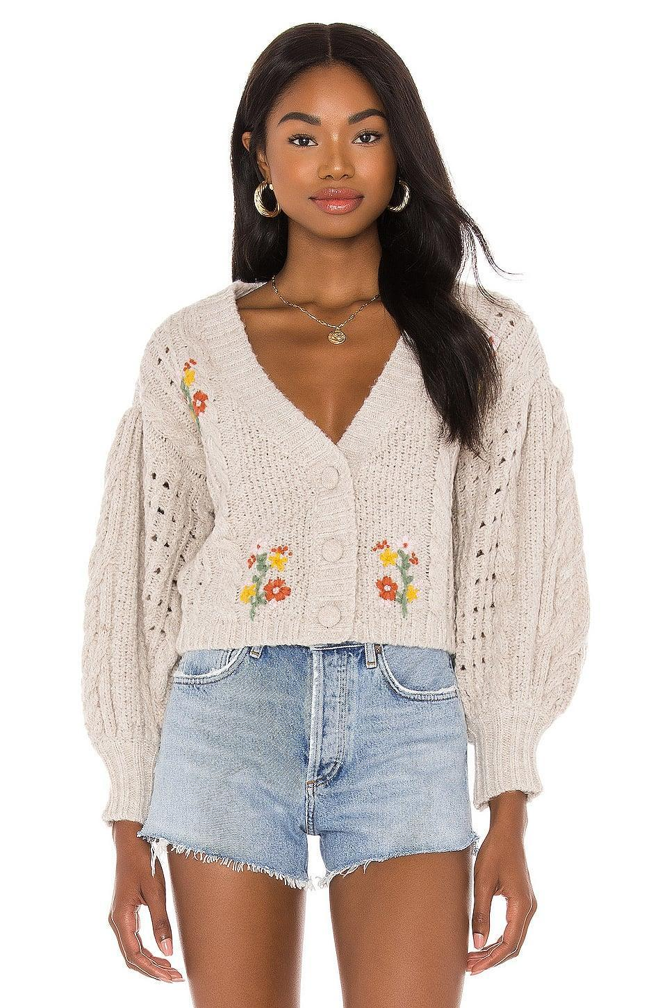 <p>How cute is this <span>For Love & Lemons Amaryllis Cropped Cardigan</span> ($172)? It makes for a perfect gift.</p>
