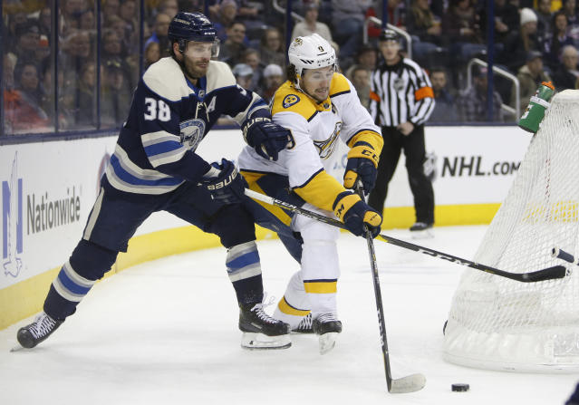 Nashville Predators' Filip Forsberg, right, of Sweden, skates behind the net as Columbus Blue Jackets' Boone Jenner defends during the first period of an NHL hockey game Thursday, Jan. 10, 2019, in Columbus, Ohio. (AP Photo/Jay LaPrete)