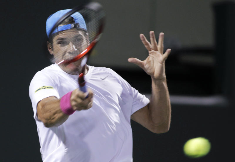 Tommy Haas, of Germany, returns the ball to Novak Djokovic, of Serbia, at the Sony Ericsson Open tennis tournament in Key Biscayne, Fla., Tuesday, March 26, 2013. Haas defeated Djokovic 6-2, 6-4. (AP Photo/Luis M. Alvarez)