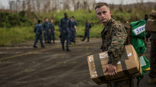 <p>U.S. Marine Corps Sgt. Cody M. Freeman, an aviation electrician assigned to the 26th Marine Expeditionary Unit (26th MEU), carries a box of supplies at Jose Aponte de la Torre Airport in Puerto Rico, Sept. 27, 2017. (Photo : Lance Cpl. Cody J. Ohira/U.S. Marine Corps via Getty Images) </p>