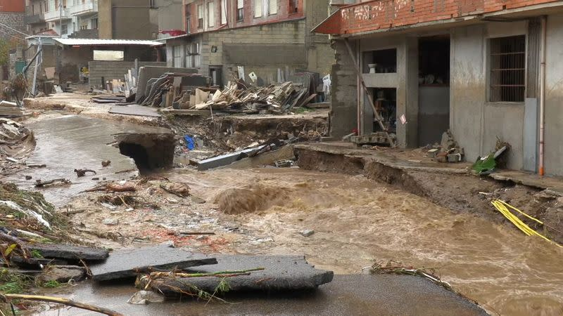 Still image taken from video shows town of Bitti affected by flash floods