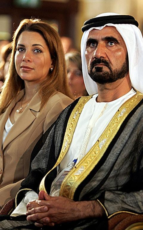 Sheikh Mohammed Bin Rashid al-Maktoum (L), Crown Prince of Dubai and UAE Defense Minister, attends with one of his wives, Princess Haya bint al-Hussein - Credit: AFP