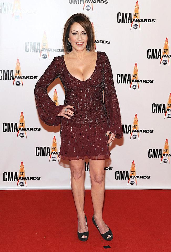 "Patricia Heaton  Grade: C-  The former ""Everybody Loves Raymond"" star attempted to strut her surgically-enhanced stuff in an age-inappropriate maroon mini and putrid peep-toes. Frederick Breedon/<a href=""http://www.gettyimages.com/"" target=""new"">GettyImages.com</a> - November 11, 2009"