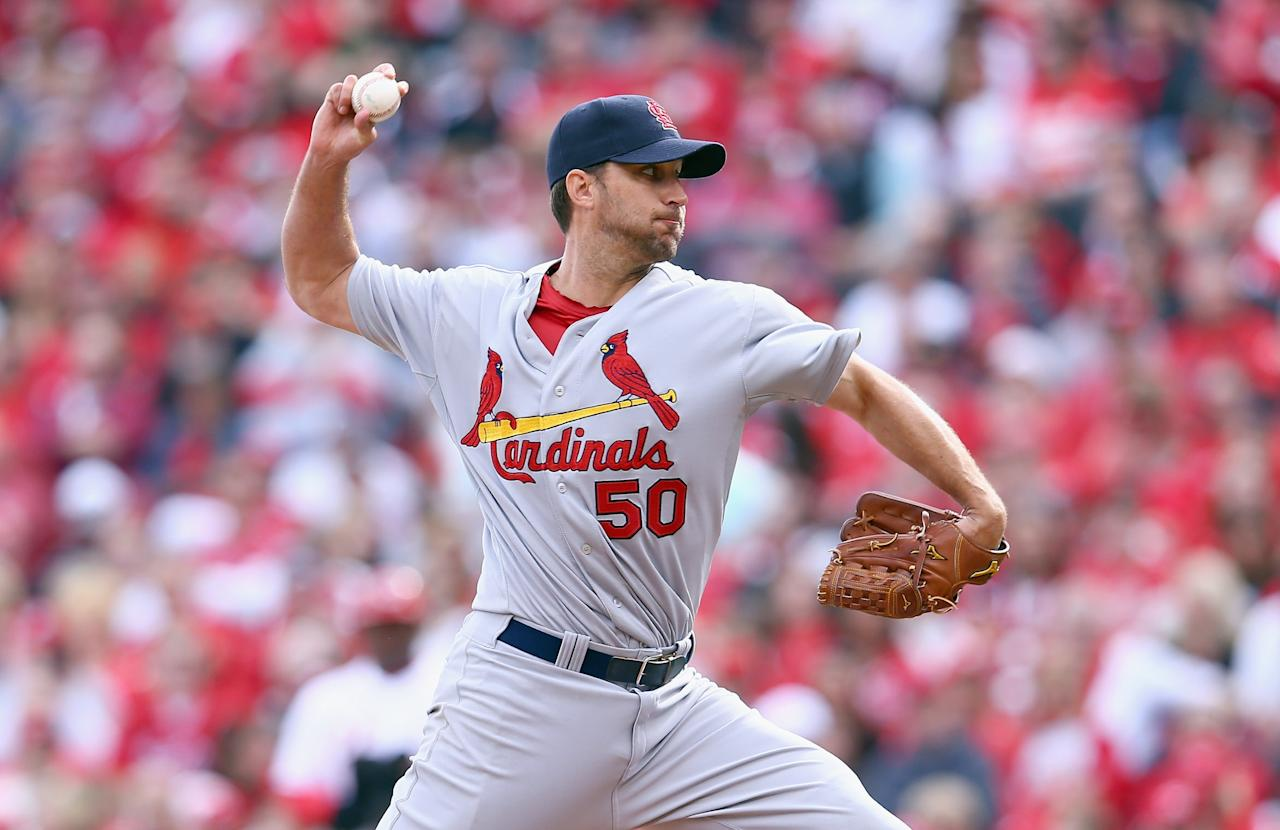 CINCINNATI, OH - MARCH 31: Adam Wainwright #50 of the St. Louis Cardinals throws a pitch in the third inning against the Cincinnati Reds on Opening Day for both teams at Great American Ball Park on March 31, 2014 in Cincinnati, Ohio. (Photo by Andy Lyons/Getty Images)