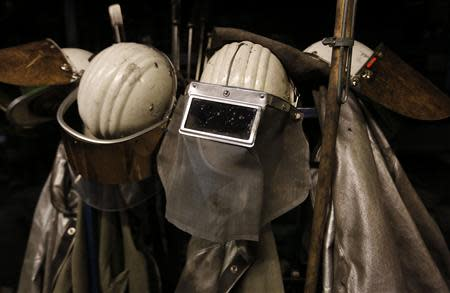 Protective coats and helmets are seen at a casting roller at ThyssenKrupp Steel Europe AG in Duisburg November 29, 2013. REUTERS/Ina Fassbender
