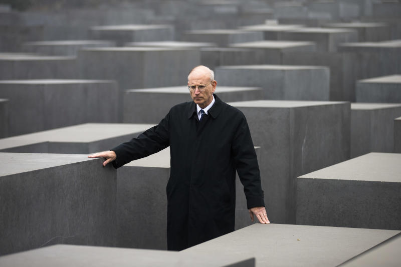 Stuart E. Eizenstat, chief negotiator of the Jewish Claims Conference walks through the Holocaust Memorial, after an interview with The Associated Press in Berlin, Thursday, Nov. 15, 2012. Sixty years after a landmark accord started German government compensation for victims of Nazi crimes, fund administrators and German officials say payments to Holocaust survivors are needed more than ever as they enter their final years. In acknowledgement of that, German Finance Minister Wolfgang Schaeuble was to sign off officially Thursday on revisions to the original 1952 compensation treaty, increasing pensions for those living in eastern Europe and broadening who is eligible for payments. (AP Photo/Markus Schreiber)