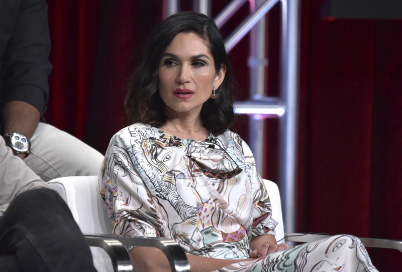 "FILE - In this Friday, July 26, 2019, file photo, Lela Loren participates in the Starz ""Power"" panel at the Television Critics Association Summer Press Tour in Beverly Hills, Calif. The series that has turned into a ratings juggernaut and already sparked plans for spinoffs begins airing its final season on Sunday, Aug. 25.  (Photo by Richard Shotwell/Invision/AP, File)"