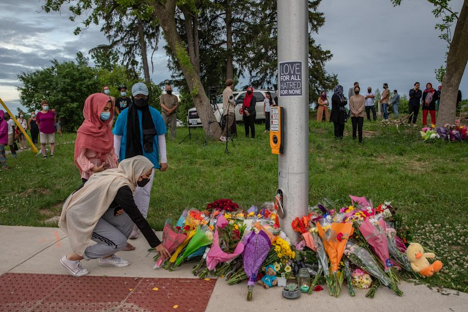 <p>Mourners leave flowers at the site where a family of five was hit by a driver, in London, Ont., Monday, June 7, 2021. Four of the members of the family died and one is in critical condition. A 20 year old male has been charged with four counts of first degree murder and count of attempted murder in connection with the crime. THE CANADIAN PRESS/Brett Gundlock</p>