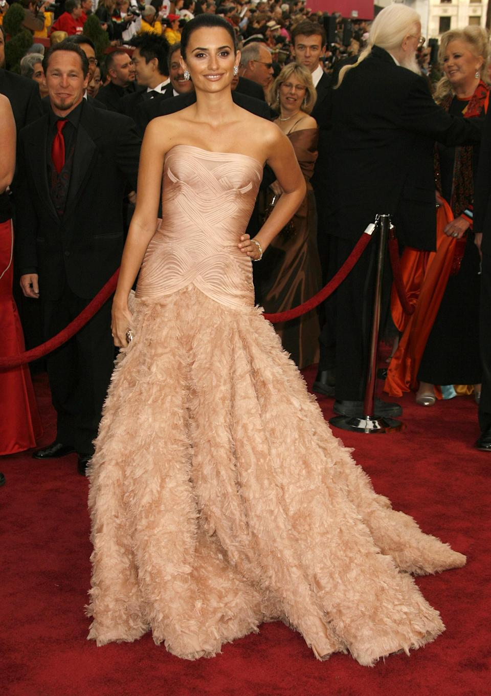 Penelope Cruz has always had strong red carpet game, but this stunning, pale pink Atelier Versace gown complete with OTT feathered train is arguably one of her best to date.