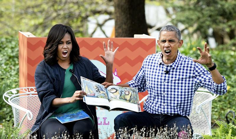 President Barack Obama and first lady Michelle Obama imitate monsters as they read <i>Where The Wild Things Are</i> during the White House Easter Egg Roll on the South Lawn of the White House on March 28, 2016 in Washington, D.C.