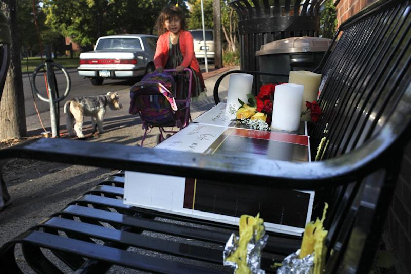 An informal memorial sits on a bench in the Bryn Mawr neighborhood Saturday, Sept. 29, 2012 in tribute to UPS driver Keith Basinski, 50, who was among five victims killed in the shooting rampage that took place late Thursday afternoon at Accents Signage Systems, Inc. in Minneapolis, Minn. Police say Andrew Engeldinger, 36, was fired from the company that afternoon and responded by fatally shooting others there before he turned the gun on himself. (AP Photo/The Star Tribune, David Joles) MANDATORY CREDIT; ST. PAUL PIONEER PRESS OUT; MAGS OUT; TWIN CITIES TV OUT