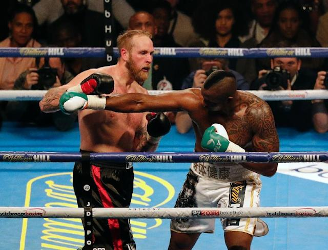 Britain's Dillian Whyte (right) fights Finland's Robert Helenius in Cardiff in October 2017 (AFP Photo/ADRIAN DENNIS)