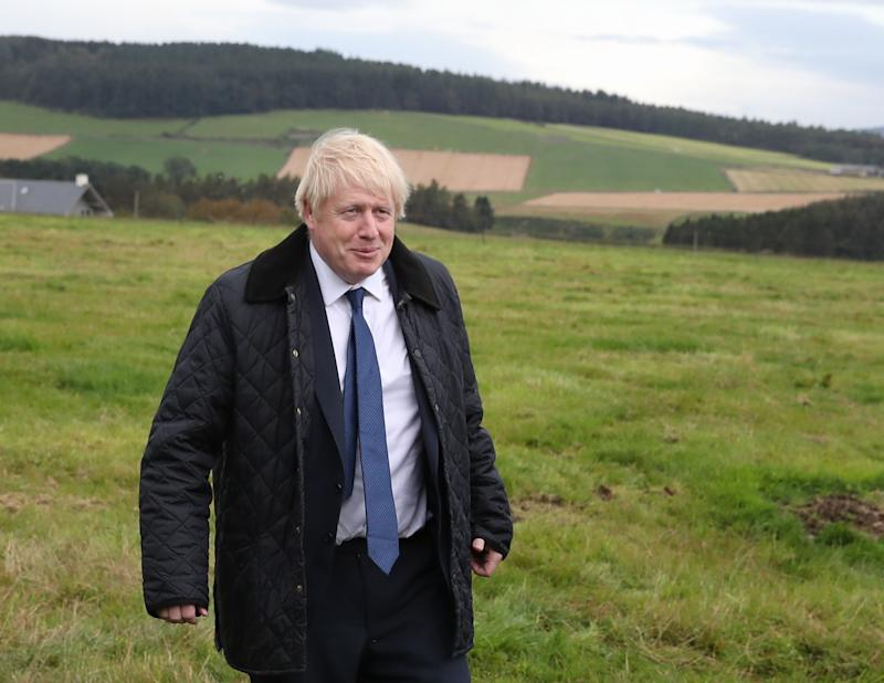 Prime Minister Boris Johnson during a visit to Darnford Farm in Banchory near Aberdeen to coincide with the publication of Lord Bew's review and an announcement of extra funding for Scottish farmers.