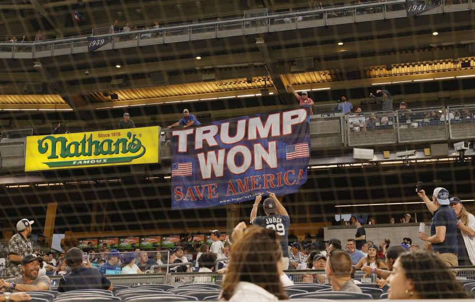 Fans unroll a banner in support of former U.S. President Donald Trump during the fourth inning of Game Two of a doubleheader between the Toronto Blue Jays and the New York Yankees at Yankee Stadium on May 27, 2021 in the Bronx borough of New York City. (Sarah Stier/Getty Images)
