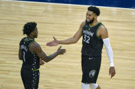 Minnesota Timberwolves center Karl-Anthony Towns (32) celebrates with Timberwolves guard Anthony Edwards (1) in the final minutes of their game against the Miami Heat during the second half of an NBA basketball game Friday, April 16, 2021, in Minneapolis. The Timberwolves won 119-111. (AP Photo/Craig Lassig)