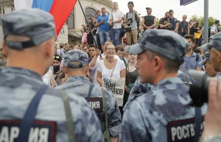 Members of Russia's National Guard line up during a rally in support of Russian investigative journalist Ivan Golunov in Moscow