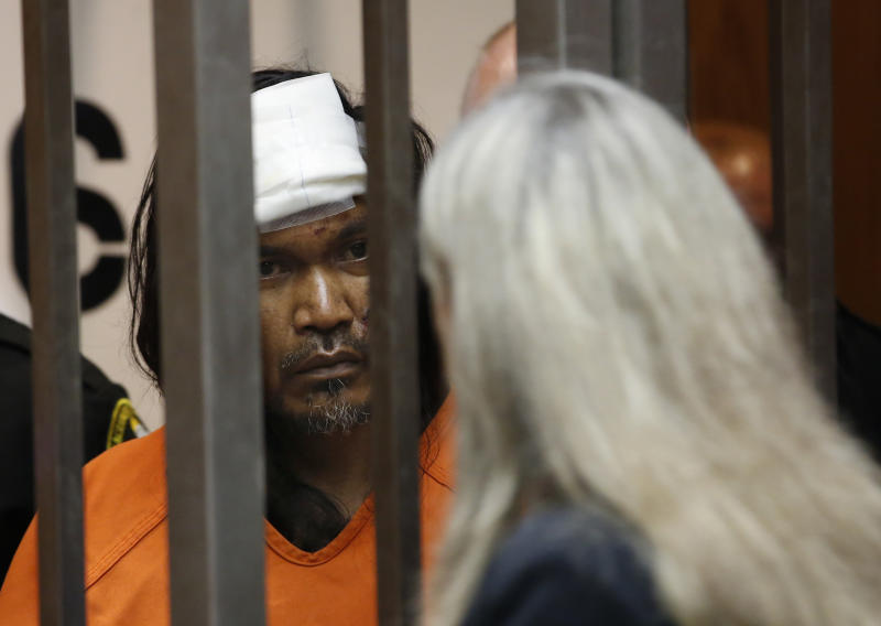 Adel Sambrano Ramos, left, huddles with his court-appointed attorney, Diane Howard, during his first court appearance in the shooting death of Sacramento Police officer Tara O'Sullivan in Sacramento County Superior Court in Sacramento, Calif., Monday, June 24, 2019. Ramos did not enter a plea. (AP Photo/Rich Pedroncelli)