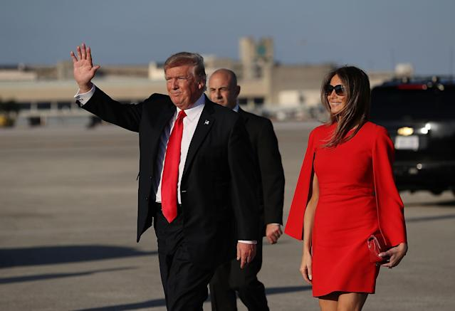 <p>Melania wore red on the tarmac for the first of many visits to Palm Beach. </p>