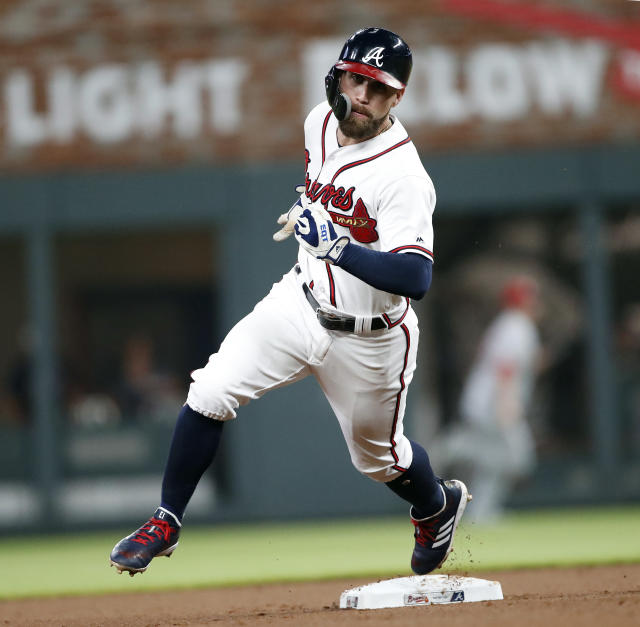 Atlanta Braves center fielder Ender Inciarte (11) rounds second base as he scores from first on an Ozzie Albies' double in the first inning of a baseball game against the Cincinnati Reds Monday, June 25, 2018, in Atlanta.(AP photo/John Bazemore)
