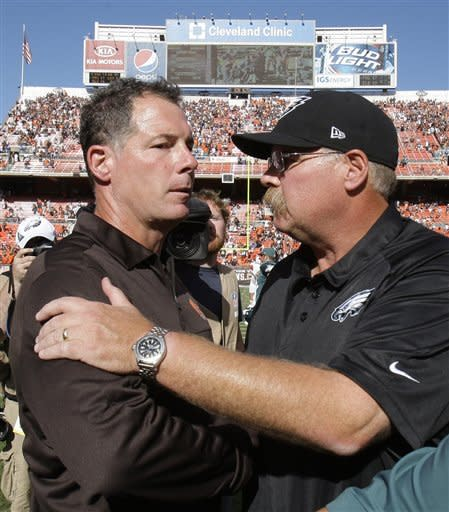 Cleveland Browns head coach Pat Shurmur, left, and Philadelphia Eagles head coach Andy Reid shake hands after the Eagles defeated the Browns 17-16 in an NFL football game on Sunday, Sept. 9, 2012, in Cleveland. (AP Photo/Tony Dejak)