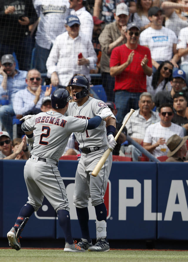 Houston Astros' Alex Bregman, left, celebrates with teammate Carlos Correa after hitting a grand slam in the fifth inning of a baseball game against the Los Angeles Angels, in Monterrey, Mexico, Sunday, May 5, 2019. (AP Photo/Rebecca Blackwell)