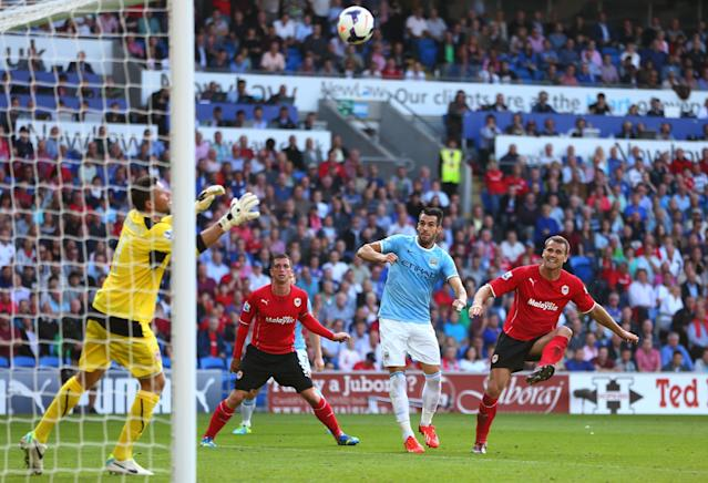 CARDIFF, WALES - AUGUST 25: Alvaro Negredo of Manchester City scores his team's second goal deep in second half injury time during the Barclays Premier League match between Cardiff City and Manchester City at Cardiff City Stadium on August 25, 2013 in Cardiff, Wales. (Photo by Michael Steele/Getty Images)