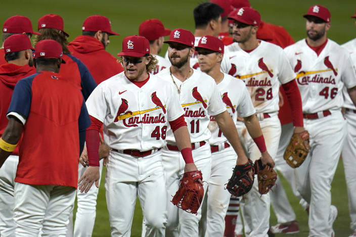 St. Louis Cardinals' Harrison Bader (48) celebrates with teammates following a 5-0 victory over the Colorado Rockies in a baseball game Friday, May 7, 2021, in St. Louis. (AP Photo/Jeff Roberson)