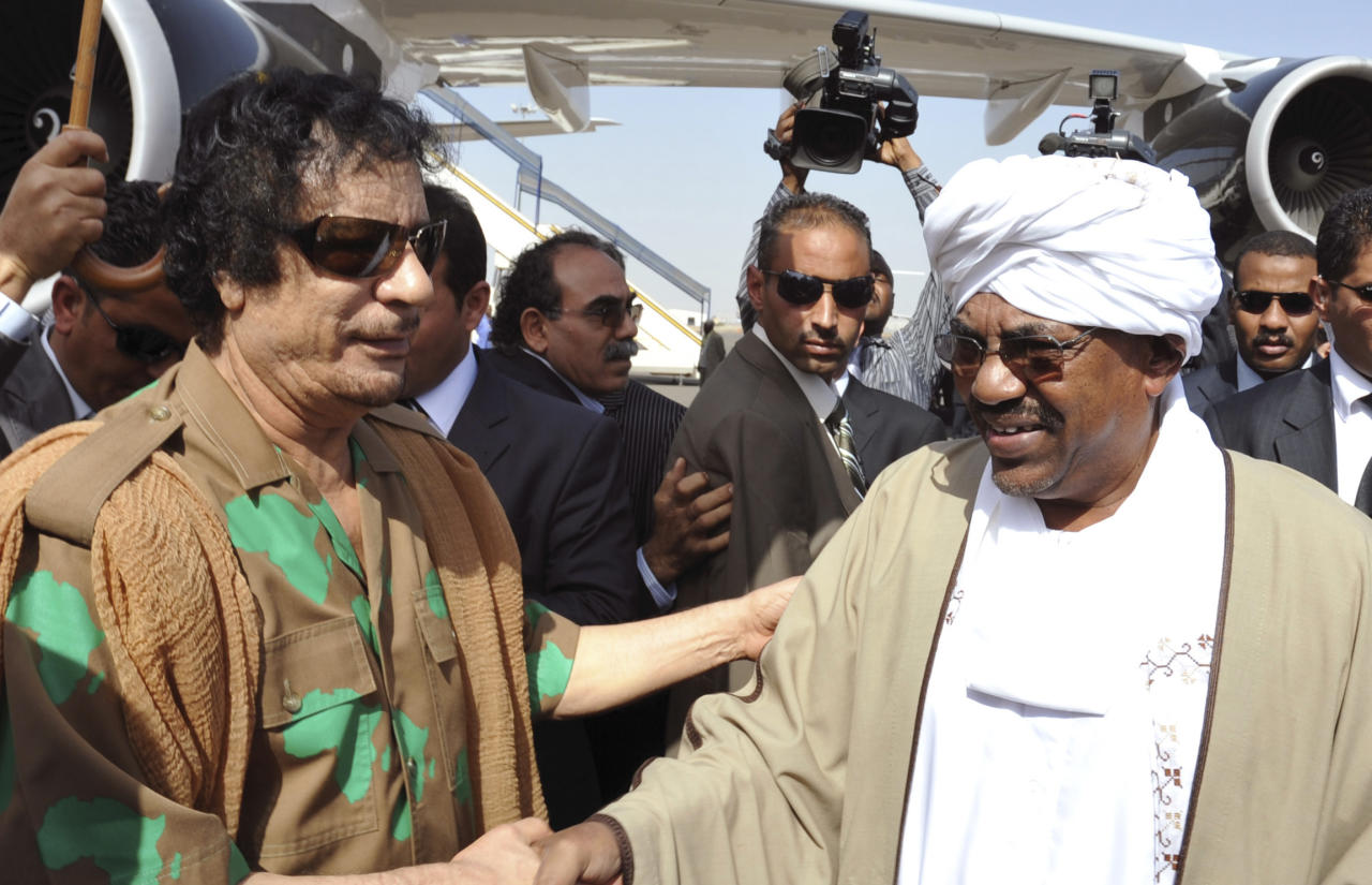 Sudanese president Omar al-Bashir, right, receives Libyan leader Muammar Gadhafi upon his arrival at the Khartoum International Airport in Khartoum, Sudan, Tuesday, Dec. 21, 2010. The leaders of Egypt and Libya were in Khartoum Tuesday for talks with Sudanese leaders on the future of Africa's largest country ahead of a referendum that's likely to break it into two.