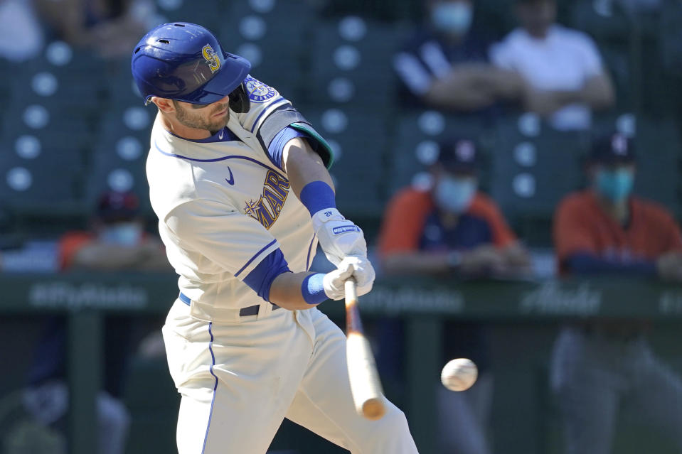 Seattle Mariners' Mitch Haniger hits an RBI-double during the seventh inning of a baseball game against the Houston Astros, Sunday, April 18, 2021, in Seattle. (AP Photo/Ted S. Warren)