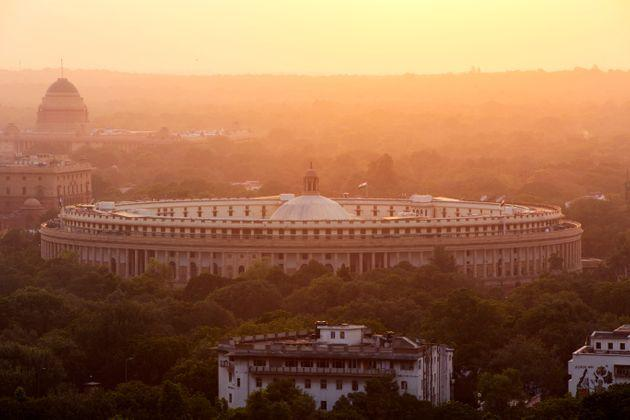 India, Delhi, New Delhi, Parliament Building at sunset, pollution, smog