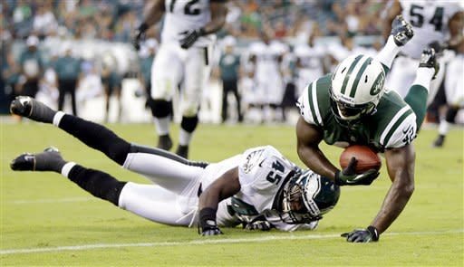 New York Jets running back Terrance Ganaway, right, scores a touchdown over Philadelphia Eagles safety Phillip Thomas in the first half of a preseason NFL football game, Thursday, Aug. 30, 2012, in Philadelphia. (AP Photo/Matt Rourke)