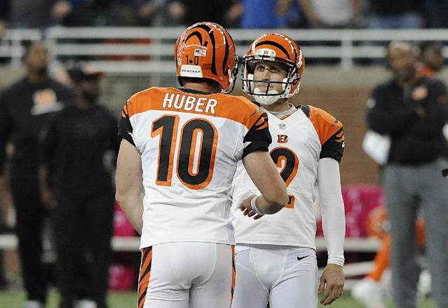 Cincinnati Bengals kicker Mike Nugent (2) is congratulated after a 54-yard field goal by Kevin Huber (10) in the fourth quarter of an NFL football game against the Detroit Lions on Sunday, Oct. 20, 2013, in Detroit. Cincinnati beat Detroit 27-24. (AP Photo/Jose Juarez)