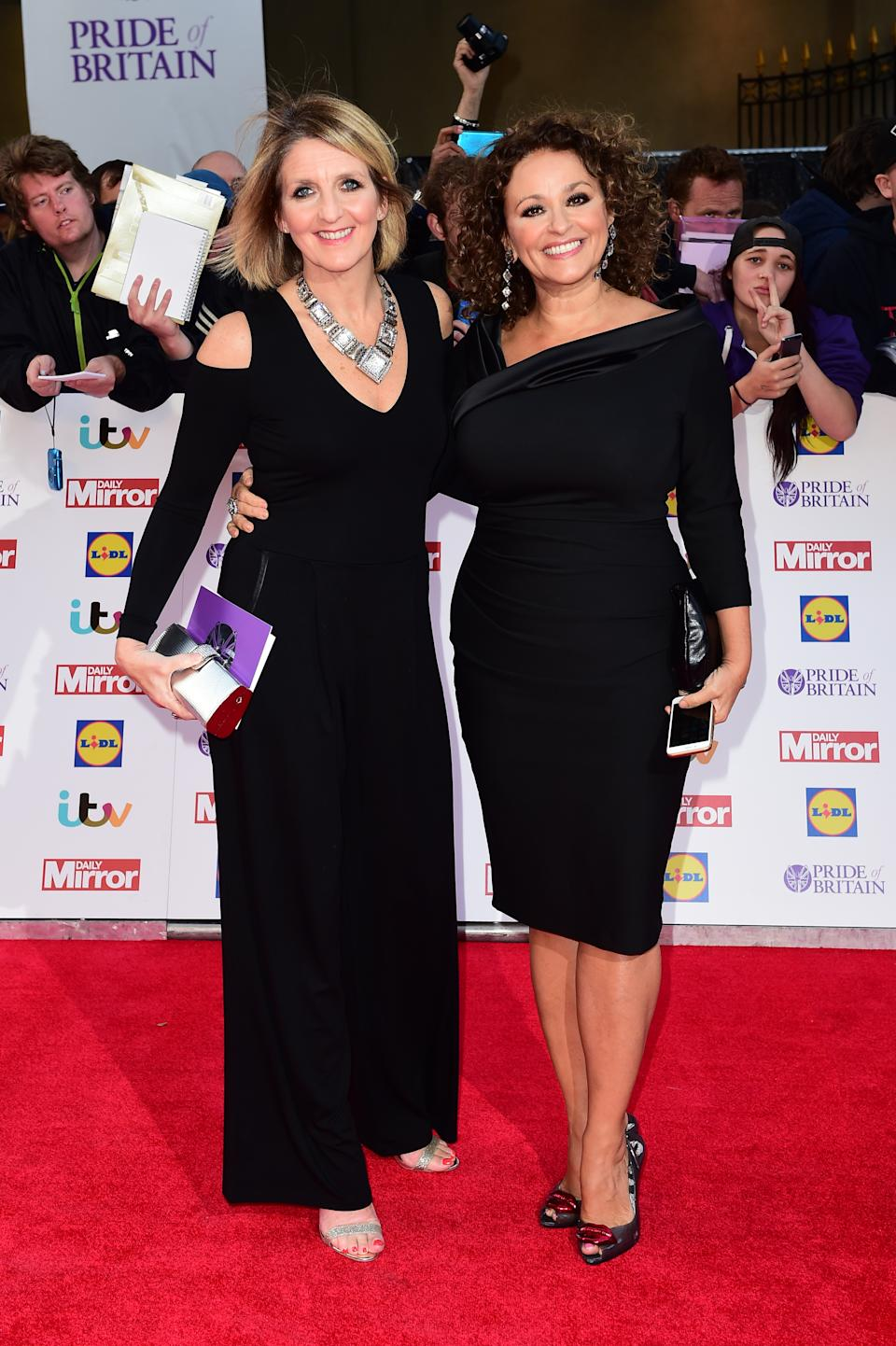 Kaye Adams (left) and Nadia Sawalha (right) arriving for The Pride of Britain Awards 2015, at Grosvenor House, Park Lane, London. PRESS ASSOCIATION Photo. Picture date: Monday September 28, 2015. See PA story Pride. Photo credit should read: Ian West/PA Wire